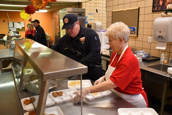 NPS Fire Fighters serve lunch to students