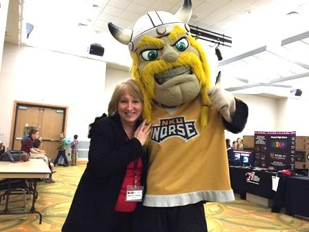 Ms. Stacey hugging the Norse Mascot
