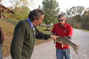 Mr. Wise shows Mr. Baker the big catch of the day.