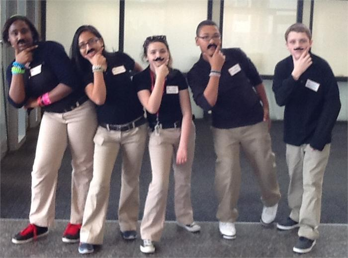 NMS students sporting their new mustache's
